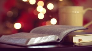 open-bible-with-warm-cup-of-coffee-christian-stock-photo